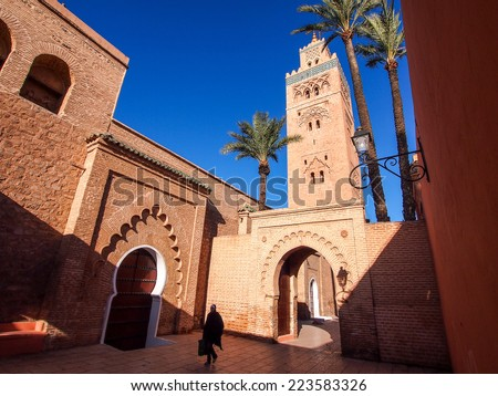 """View of the tower of the ancient mosque """"Koutoubia"""" of Marrakech in Marocco - stock photo"""