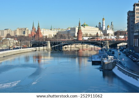 View of the Towers of the Kremlin and the Moscow river Embankment winter day. Moscow river and the Kremlin in Moscow. - stock photo