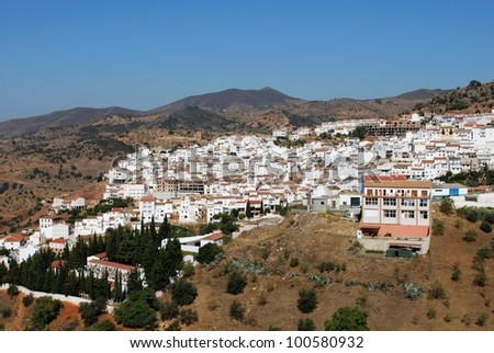 View of the town and surrounding countryside, Almogia, Costa del Sol, Malaga Province, Andalusia, Spain, Western Europe. - stock photo