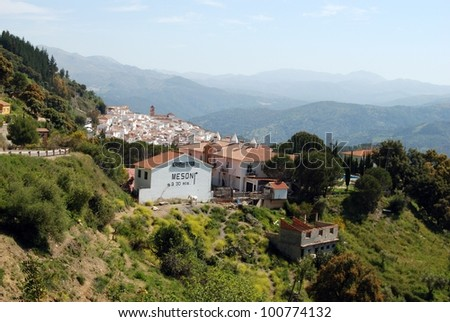 View of the town and surrounding countryside, pueblo blanco, Algatocin, Costa del Sol, Malaga Province, Andalusia, Spain, Western Europe. - stock photo