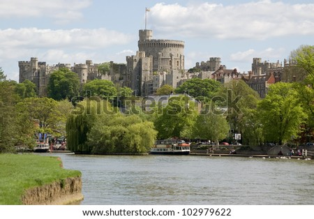 View of the town of Windsor from the banks of the River Thames in Berkshire. - stock photo