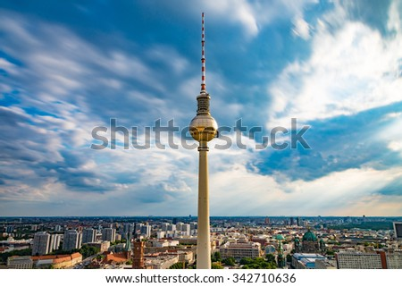 View of the TV tower at Alexanderplatz in Berlin, Germany with a cloudy blue sky.Taken from the roof of the Park Inn Hotels - stock photo