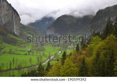 view of the valley in the Swiss Alps - stock photo