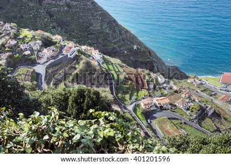View of the village of Porto Moniz with lava-rock pool, Madeira Island, Portugal - stock photo