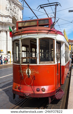 View of the vintage famous red electrical trams circulating still today in Lisbon, Portugal. September 14, 2014
