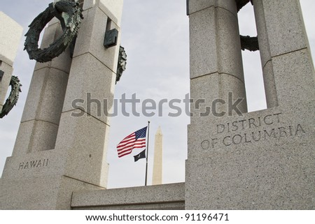 View of the Washington Monument, American Flag and the World War II Memorial in DC