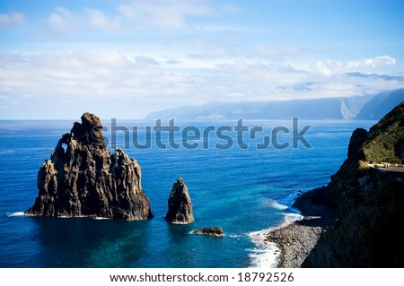View of the Western Madeira coast with yellow taxi - stock photo
