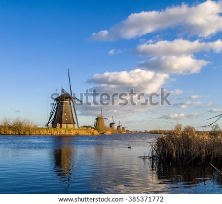 View of the windmills at Kinderdijk Holland under a beautiful sky - stock photo