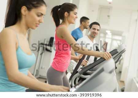 View of the young woman training in the gym - stock photo