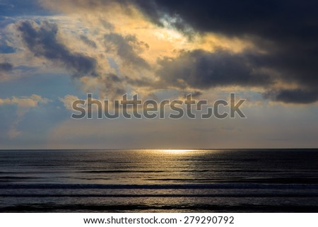 View of thunderstorm clouds above the sea on sunshine - stock photo