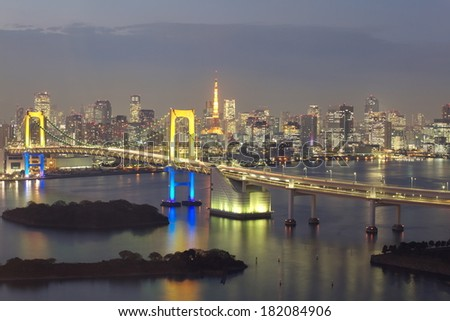 view of tokyo bay and tokyo city with rainbow bridge and tokyo tower - stock photo