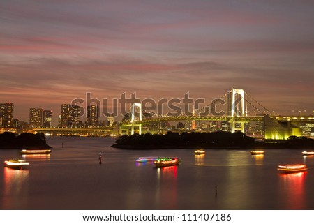 View of Tokyo cityscape at night with Rainbow Bridge and Tokyo Tower