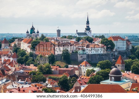 View of Toompea hill with tower Pikk Hermann, Cathedral Church of Saint Mary Toomkirik and Russian Orthodox Alexander Nevsky Cathedral from the tower of St. Olaf's church, Tallinn, Estonia - stock photo