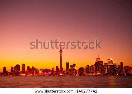 View of Toronto Night Sky Light taken from Central Island - stock photo