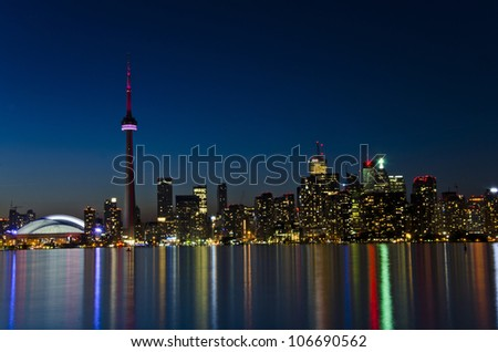 View of Toronto skyline in the dusk hour, beautiful light colours reflected on the lake water