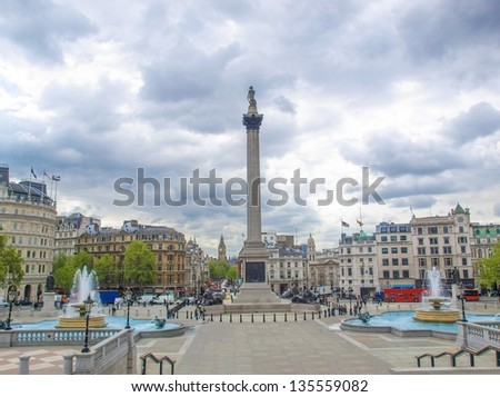 View of Trafalgar Square in London from the National Gallery porch, with unrecognisable crowd - stock photo