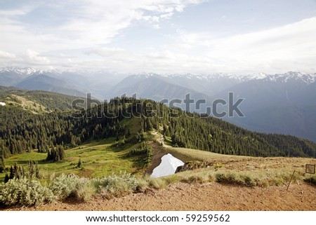View of trail with from high mountain peak. - stock photo