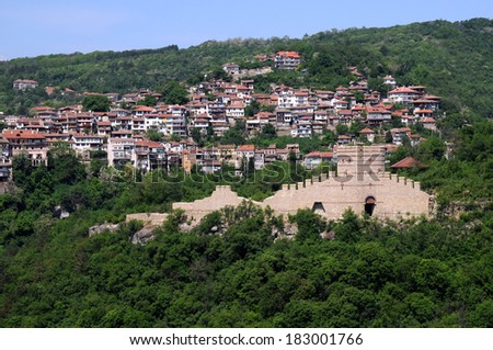 View of Trapezitsa hill with the medieval fortress and residential area in the background - stock photo