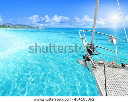 View of tropical beach from yacht. - stock photo