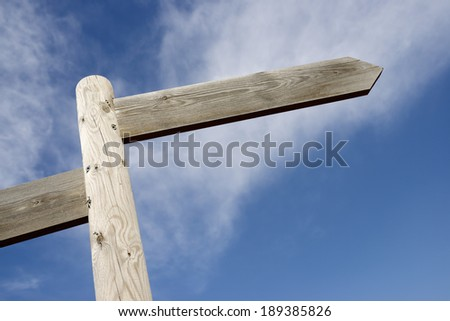 View of two directional wood signals - stock photo