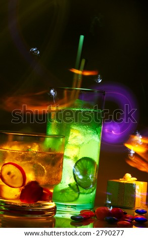 view of two glasses of nice colorful fresh soft drinks and sparks on it's back