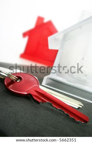view of two keys with silver house figure - stock photo