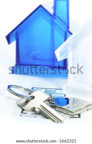 view of two keys with silver house figure on the white - stock photo
