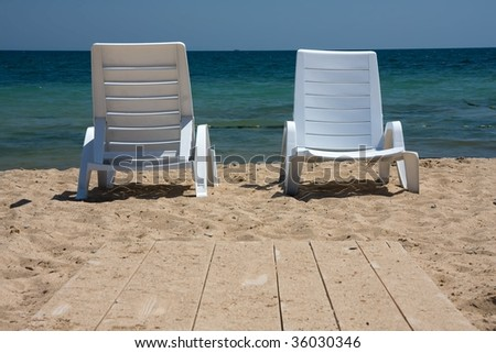 View of two nice chairs on beach