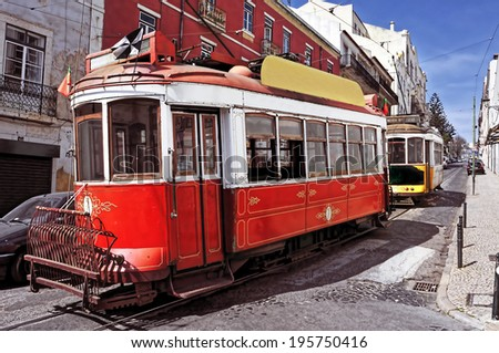 view of two typical old trams in Lisbon, Portugal - stock photo