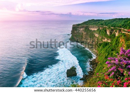 View of Uluwatu cliff with pavilion and blue sea in Bali, Indonesia - stock photo
