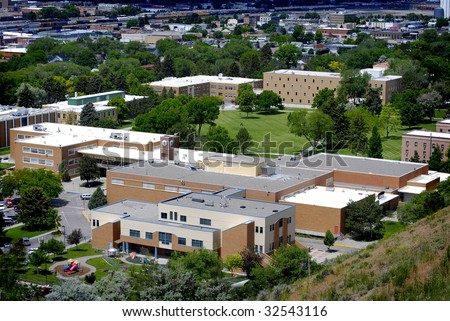 View of university campus with buildings and campus grounds - stock photo
