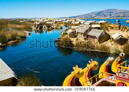 View of Uros floating islands with typical boats, Puno, Peru - stock photo
