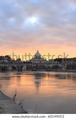 view of Vatican reflected on Tiber river in Rome at sunset - stock photo