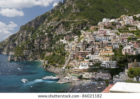 View of village against mountain cliff, face at the Amalfi Coast Italy - stock photo