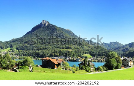 View of village near the lake in the Alps mountains. Austria