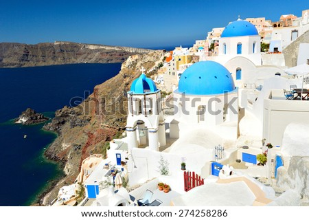 View of volcanic caldera and beautiful village of Oia with its whitewashed blue domed churches, Oia, Santorini, Greece, Europe - stock photo