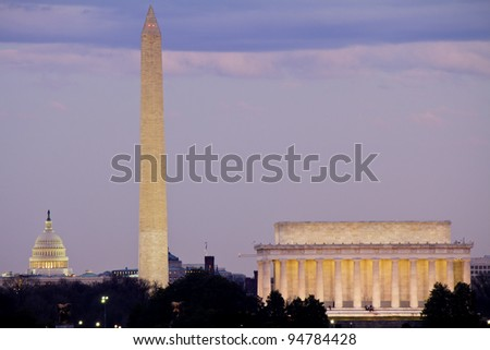 View of Washington DC at dusk with Capitol, Washington Monument and Lincoln Memorial in line - stock photo