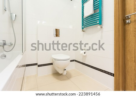 View of white bathroom with black elements
