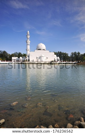 View Of White Floating Mosque On Daylight  - stock photo