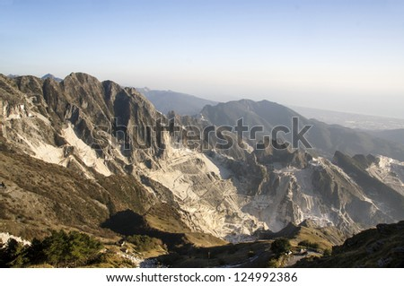 View of white marble quarries from Campocecina, a mountain location in northern Apuan Alps, Carrara (Tuscany, Italy). - stock photo