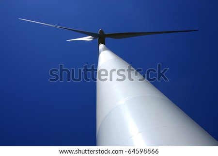 view of white  pylon and rotary of wind mill power plant - stock photo