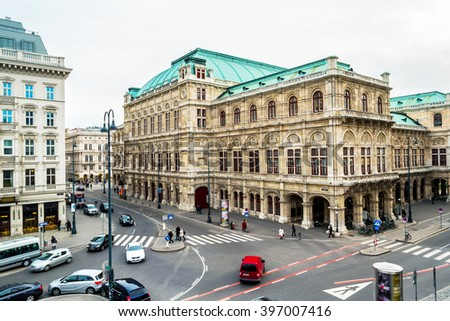 View of Wiener Staatsoper (Vienna State Opera) in Vienna, Austria during the day. Cloudy weather, bright sky, car traffic - stock photo