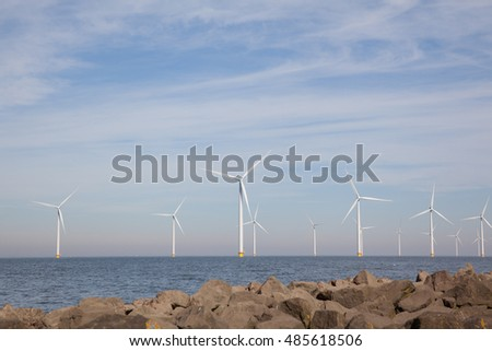View of windpark in the Dutch Noordoostpolder, Flevoland and the IJsselmeer, near the town of Urk.
