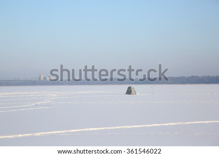 View of Winter fishing under the tent on the lake - stock photo