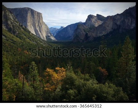 View of Yosemite Valley during fall from the famous Tunnel View Vista on Wawona Road Yosemite National Park, Mariposa County, California, USA - stock photo