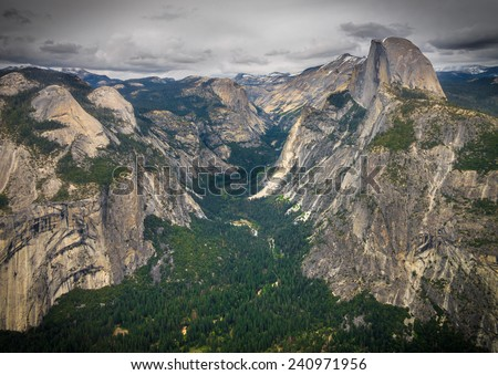 View of Yosemite Valley from Glacier Point Overlook.   Half Dome can be seen - stock photo