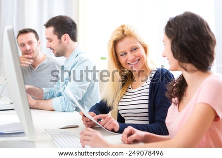 View of Young attractive people working together at the office  - stock photo