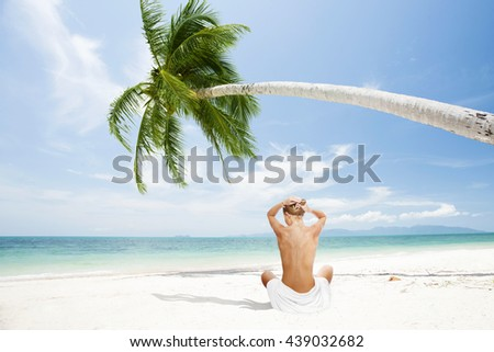view of young beautiful woman in tropical beach environment