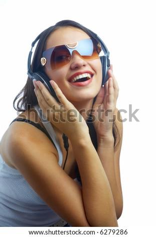 view of young nice girl listening music via earphones - stock photo