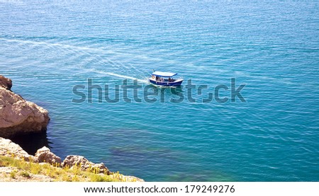View on a swimming ship from a high mountain